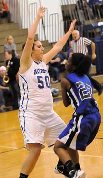 Bryan's Whitney Meyer (50) defends against Conway's Claire Hobbs. (Photo by Kevin Nagle)