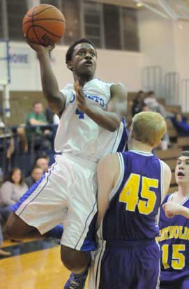 K.J. Hill (4) shoots over Catholic's Kirk Hutchins (45). (Photo by Kevin Nagle)