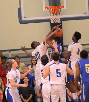 J.C. Newborn blocks a North Little Rock shot. (Photo by Kevin Nagle)