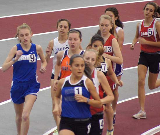 Bryant's Hannah Raney, left, competes in the 3200 meter run at the State Indoor championships Saturday.