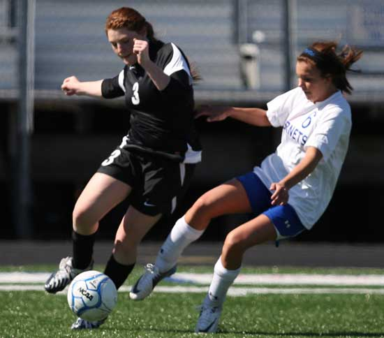 Bryant's Katie Barrington battles with an opponent for a loose ball. (Photo by Rick Nation)