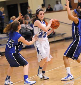 Mallory Curry (22) tries to protect the ball from a double-team. (Photo by Kevin Nagle)