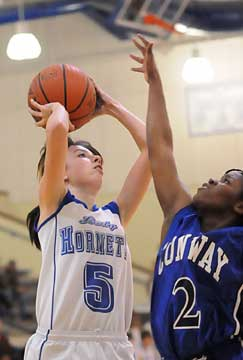 Bryant's Destiny Huffman (5) tries to get her shot away over Conway Blue's Briana Ester. (Photo by Kevin Nagle)