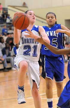 Taylor Lindberg (21) goes up for a shot in front of Conway Blue's Breanna Donohoo. (Photo by Kevin Nagle)