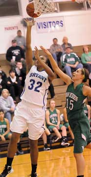 Bryant's Taneasha Rhode (32) arrives for a layup in front of Van Buren's Brittney Campbell. (Photo by Kevin Nagle)