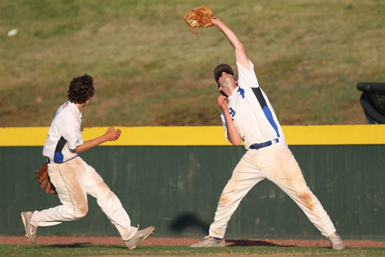 Bryant first baseman Dylan Cross hauls in a foul pop as teammate Ozzie Hurt scampers to cover first. (Photo by Rick Nation)