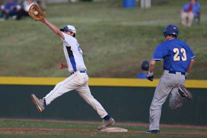 Dylan Cross stretches for a throw at first base. (Photo by Rick Nation)