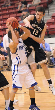Jordan Griffin (5) is contested by Bentonville's David Frost. (Photo by Kevin Nagle)