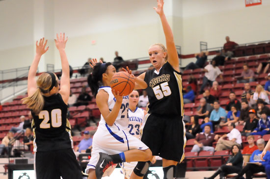 Bryant's Kiara Moore drives to the basket against Bentonville's Julia Garrard. (Photo by Kevin Nagle)