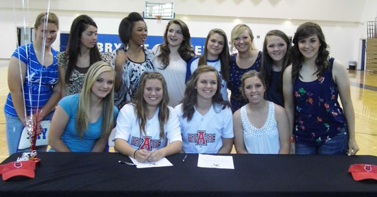 Brittney Ball and Ashley Chaloner are joined by their teammates as they sign with Arkansas State.
