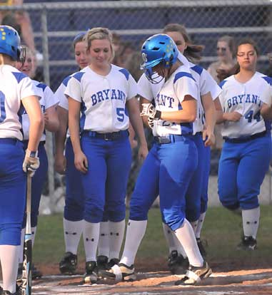 Kayla Sory is greeted by her teammates after her first-inning home run. (Photo by Kevin Nagle)