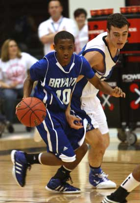 Bryant's Anthony Black clears the ball, working up the floor under pressure. (PHoto by Rick Nation)