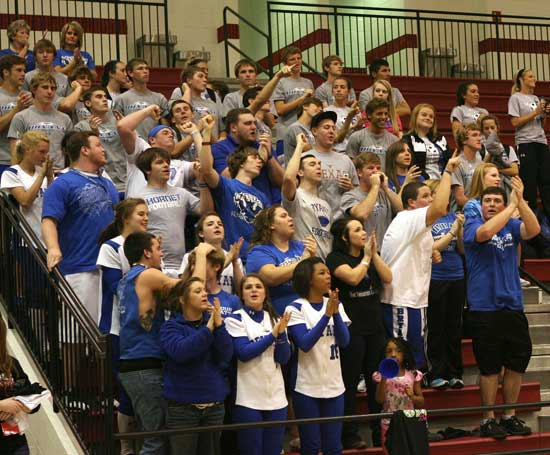 After collecting wins of their own, members of the Bryant soccer and softball teams joined in the cheering at the basketball team's win at the State Tournament Thursday night in Cabot. (Photo by Rick Nation)