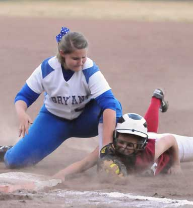 Bryant first baseman Kaley Coppock applies a tag on a pick-off play. (Photo by Kevin Nagle)