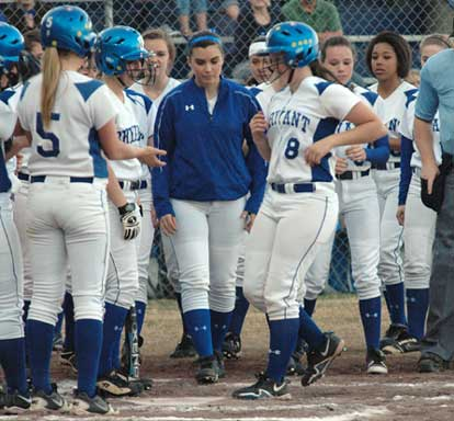 The Lady Hornets greet Jessie Taylor after her three-run homer. (Photo by Val Nagle)