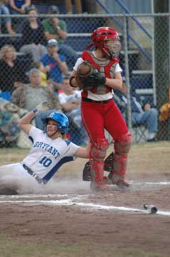 Cassidy Wilson slides safely home. (Photo by Val Nagle)