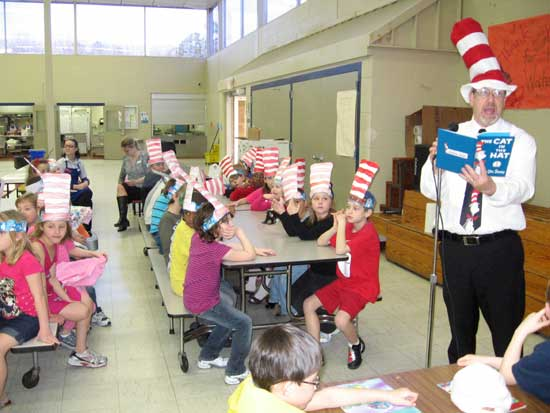 Bryant Elementary School principal Dean Burbank reads to the students.