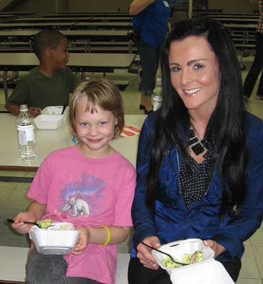 Araina Camron enjoys some green eggs and ham with BES assistant principal Jordan Eason.