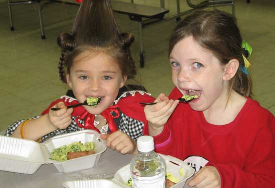 Taylor Moore and Jodi Bates enjoy some green eggs and ham from IHOP.