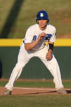 Josh Pultro leads off first. (Photo by Rick Nation)