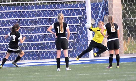 Bryant keeper Kaitlyn Miller dives for a save. (Photo by Kevin Nagle)