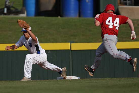 Josh Pultro stretches for a throw to first to retire Cabot's T.C. Carter. (Photo by Rick Nation)