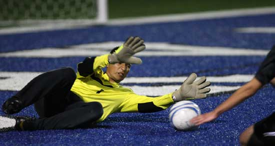 Bryant keeper Victor Rodarte tries make a save. (Photo by Rick Nation)