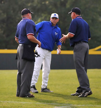 Bryant head coach Kirk Bock discusses a call with the umpires. (Photo by Kevin Nagle)