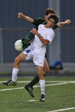 Bryant's Dylan Wolf (4) gets tangled up with a Van Buren player. (Photo by Rick Nation)