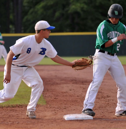 First baseman Josh Pultro (8) holds Van Buren's Cole Plunkett close at first. (Photo by Kevin Nagle)