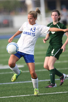 Bailey Gartrell (13) works to control the ball. (Photo by Rick Nation)