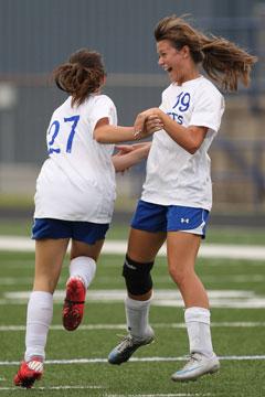 Kara Taylor (27) and Emily Pierce (19) celebrate Taylor's goal. (Photo by Rick Nation)