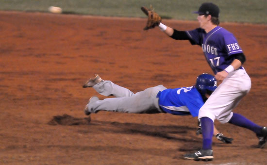 Bryant's Trevor Ezell dives back into first on a pick-off play. (Photo by Kevin Nagle)