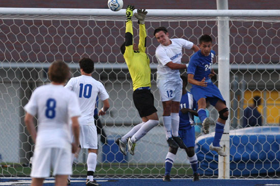Bryant's Bryce Denker (12) tries to head in a shot in a crowd in front of the Conway goal. (Photo by Rick Nation)