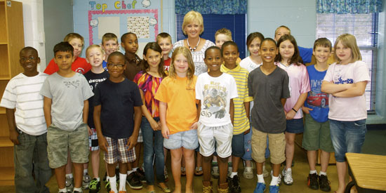 Kathy Daniel and her third-grade class at Davis Elementary. (Photo by Michael Kornegay)
