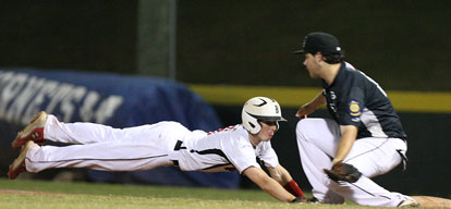 Bryant first baseman Landon Pickett takes a pickoff throw as a Benton baserunner dives back into the bag. (Photo by Rick Nation)