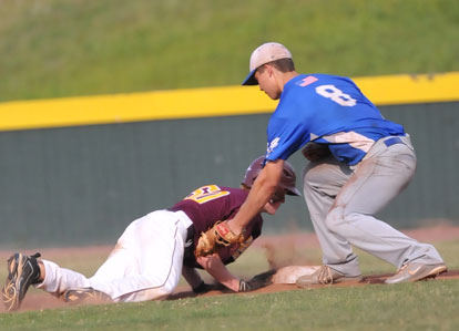 Josh Pultro (8) applies a tag on a pickoff play against John Michael Lipton. (Photo by Kevin Nagle)