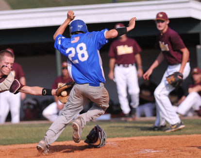 Bryant's Drew Tipton (28) tries to avoid the tag of Lake Hamilton catcher Carter Greathouse, left. (Photo by Kevin Nagle)