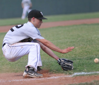 Third baseman Harrison Dale, reaches for a slow roller. (Photo by Kevin Nagle)