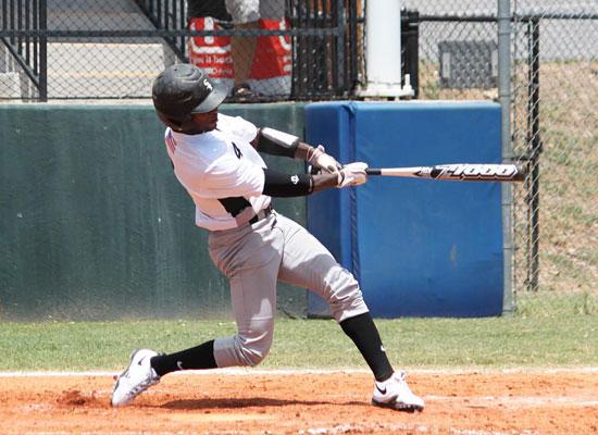Marcus Wilson follows through on his three-run homer. (Photo by Phil Pickett)