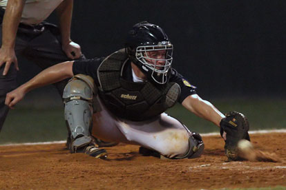 Bryant catcher Zach Graddy short-hops a pitch. (Photo by Rick Nation)