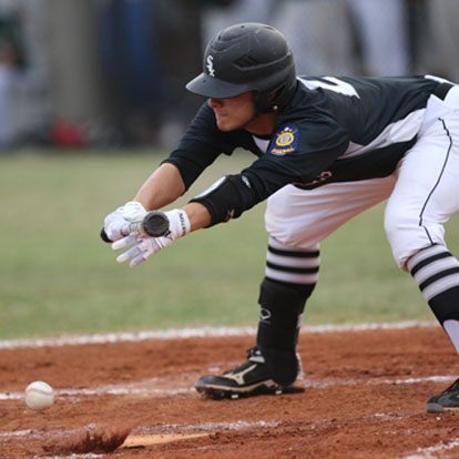Tyler Nelson executes a squeeze bunt. (photo by Rick Nation)