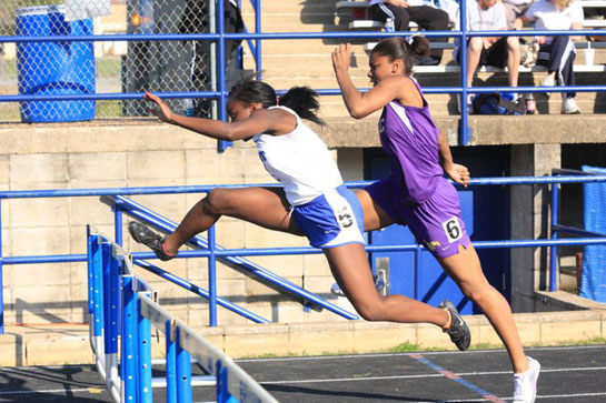 Alexis Royal clears a hurdle at the Hornet Relays earlier this year. (Photo courtesy of Steven Murdock)