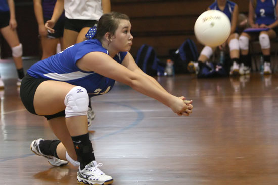 Brooke Howell digs up a hit during Thursday's jamboree. (Photo by Rick Nation)