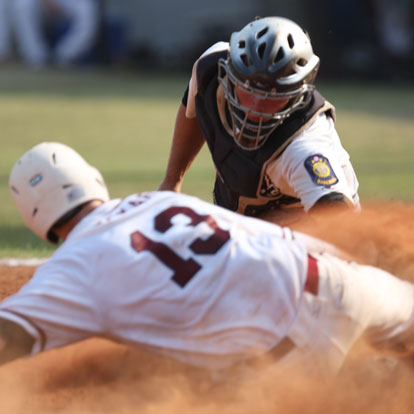 Bryant catcher Hayden Lessenberry tags out Texarkana's Alan Copeland after a strike to the plate from Marcus Wilson in centerfield to end the top of the third inning. (Photo by Rick Nation)