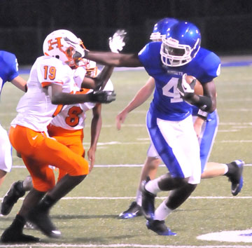 Greyson Giles (4) gets past Little Rock Hall defender Roddrick Collier (19). (Photo by Kevin Nagle)