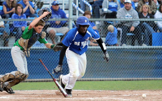 Cameron Coleman heads to first on his tapper in front of the plate. (Photo courtesy of Teresa Smith, Northwest Sports Photography)