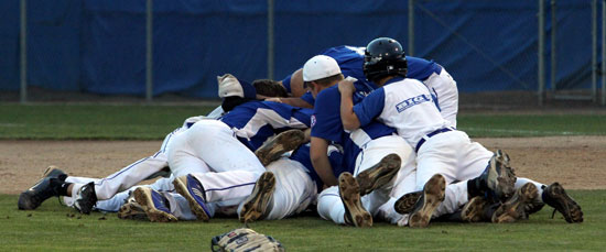 The Bryant 13-year-old All-Stars dogpile after closing out their 4-3 win over Greenville, N.C. (Photo by Teresa Smith, Northwest Sports Photography)