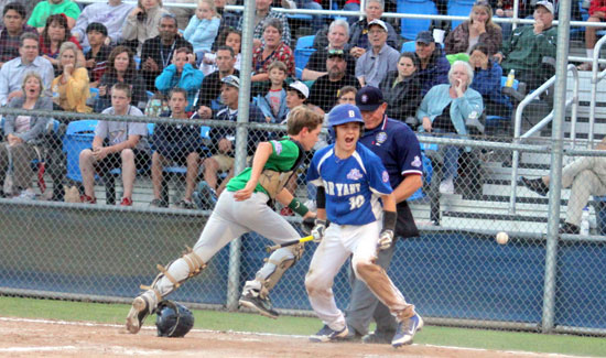 Bryant's Garrett Misenheimer celebrates after scoring the tying run on Jeffery Hastings' squeeze bunt in the bottom of the sixth inning as Greenville catcher Coleman Sawyer chases after an errant throw. (Photo courtesy of Teresa Smith, Northwest Sports Photography)