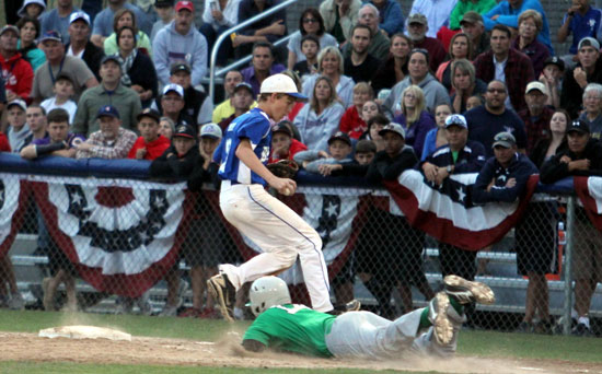 Aaron Orender steps past first base after recording the final out of the 2012 Babe Ruth World Series championship game, beating Greenville, N.C., runner Colin Smith. (Photo courtesy of Teresa Smith, Northwest Sports Photography)